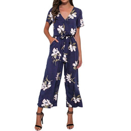 ec4aea862011 Women Floral Jumpsuit V Neck Belted Loose Playsuit Ladies Summer Short  Sleeve Romper Elegant Workwear  10