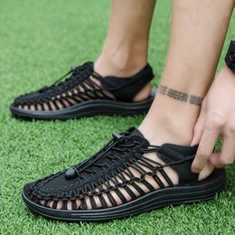 mens hand bands Australia - Summer 2019 Beach Hot Outdoor Fashion Rome Hand-knitted Elastic Band Casual Mesh Women Man Shoes Sandles New Mens Sneakers Flat