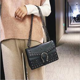 $enCountryForm.capitalKeyWord Australia - New Korean ins fashion designer Punk style heavy work rivet Bacchus bag shoulder diagonal tide handbag