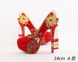 Viento chino phoenix borla tostada zapatos de novia altos con multa con zapatos de fotografía 2019 nuevo matrimonio femenino en venta