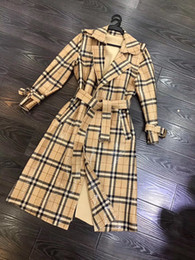 Wholesale european fashion trench coats for sale - Group buy European and American women s clothing winter new style Long sleeved lapel plaid bright face fashion lace up Trench coat