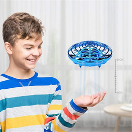 Remote flying ufo online shopping - Hot UFO Gesture Induction Suspension Aircraft Smart Flying Saucer With LED Lights Creative Toy Entertainment New Year Christmas Gift