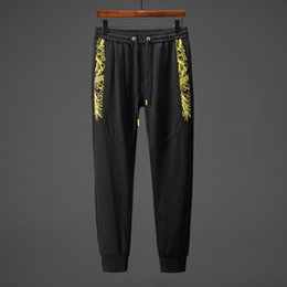 $enCountryForm.capitalKeyWord NZ - 2019 new hot men and women models spring and autumn cotton yellow hollow wave printing temperament personality couple pants