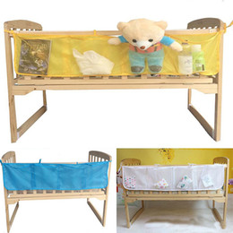 Cot Toys For Babies Australia - Hanging Storage Bag Baby Cot Bed Brand Baby Crib Organizer Toy Diaper Pocket For Crib Bedding Set Storage Bed Bumper