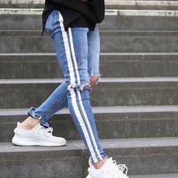 d2b4464bf3 Men denim ripped hole Jeans side striped line Jeans Fashion Hip hop Skinny  pencil For Men stretch ankle zipper black