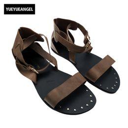 Vogue Sandals UK - Roman Mens Shoes Vogue Fashion Buckle Hollow out Strap Gladiator Flats Shoes For Man Leather Sandals Studded Punk