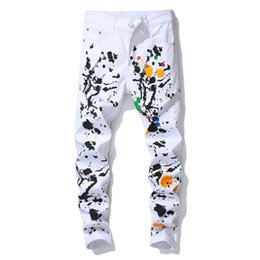 Hip Hop Stretch Pants NZ - New trendy slim fit stretch men's white oil paint casual trousers ink painted graffiti pencil pants for men hip hop stage style