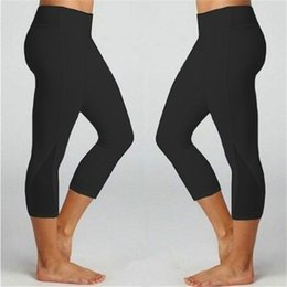 ladies wearing yoga pants Australia - Solid Color Exercise Pants Sexy Lady Yoga Outfits Lift Butts Fitness Capris Women Skinny Yoga Leggings Mid Waist Active Wear
