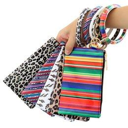 PU Keychain Armband Brieftasche Frau Handtasche Sonnenbrüche Leder Quaste Anhänger Leopard Sonnenblume Print Damen Tasche Geschenk A03 im Angebot