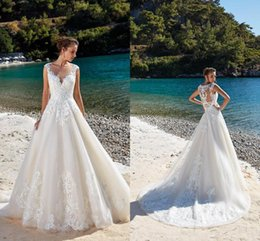 1a2f274224e63 Elegant Lace A Line Summer Beach Wedding Dresses 2019 Sheer Mesh Top Tulle  Applique Court Train Wedding Bridal Gowns With Button BC1310