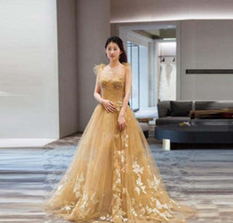 China Fashion Evening Gowns UK - Gold Spaghetti Strap Backless Sexy Lovely Long Evening Dresses in China Gorgeous Prom Dresses 2019 Applique Sexy Evening Gowns