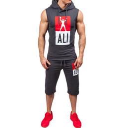 Venta al por mayor de Traje de running para hombres Entrenamiento físico sin mangas Ropa suelta para hombre Ropa deportiva Running Wear 2018 Nuevo traje deportivo de diseñador para hombre