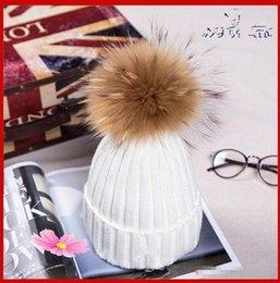Venta al por mayor de Nuevo invierno francés de punto las mujeres sombrero de piel real espesan con bola mullida real en un casquillo de la muchacha caliente gorrita cerrarse de nuevo de vuelta gorro esponjoso