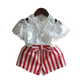 Girls Lace Summer Shorts Set UK - Kids Girls Clothing Sets Solid Hollow Lace Strapless Shoulder Shirts Kids Designer Clothes Bow Strap Striped Elastic Shorts Pearl Necklace