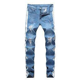 Vente en gros Jeans de créateur pour hommes KANYE WEST Ripped Distressed Long Jean rayé bleu clair Pantalon de mode Pantalon