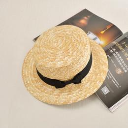 Flat Hats For Women Australia - 2016 summer Flat sun hats for women chapeau feminino straw hat panama style cappelli Side with bow Beach bucket cap girl topee C18122501