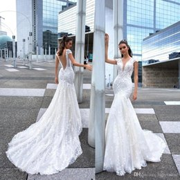 d6d58ef4f81 2019 Crystal Design Mermaid Wedding Dresses Sexy Deep V Neck Lace Beads  Crystals Country Bridal Gowns Sweep Train Boho Wedding Dress