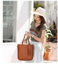 $enCountryForm.capitalKeyWord NZ - New Korean version of the bucket tassel women's shoulder bag mother bag four-piece slanting mobile phone coin purse pouch