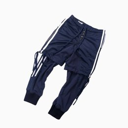 Chinese  19ss Greg Lauren Track Pants Button Patchwork Sweatpants Kanye West Men Fashion Casual Pants Sports Zipper Strap Pants HFTTKZ034 manufacturers