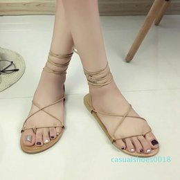 casual black tie NZ - Summer Women Gladiator Flat Heels Strappy Cross-tied Sandals Ladies Casual Solid Lace-Up Black Khaki Sandals Size 35-39 c18