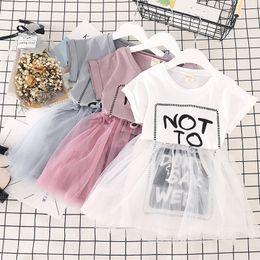 Cute korean dress skirt online shopping - Korean design baby girls mesh skirts Letters printed cute girl tutu dress white grey pink children summer clothes