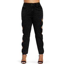 sexy black leather hole NZ - fashion Plus Size High Waisted Skinny Jeans Women Sexy Hollow Out Pemcil Denim Plants Trousers Bow Black Ripped Jeans Femme 2019