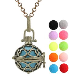 bronze heart locket pendant UK - Antique Bronze Love Heart Aromatherapy Perfume Essential Oil Locket Lava Beads Diffuser Ball Cage Angel Bola Chime Ball Necklace With Chain