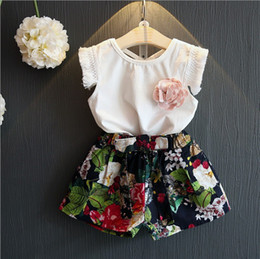 $enCountryForm.capitalKeyWord Australia - New design baby girls summer fashion outfits White T-shirt tank top vest with tassel sleeve+floral shorts 2pcs set baby girls clothing set