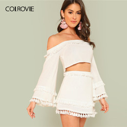 2646f5d440f wholesale White Off the Shoulder Tassel Trim Crop Top and Skirt Set Women  2019 Spring Long Flounce Sleeve Vacation Two Piece Set