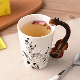 guitar handle NZ - Creative Music Violin Style Guitar Ceramic Mug Coffee Tea Milk Stave Cups with Handle Coffee Mug Novelty Gifts T200506