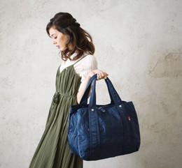 Small Hand Luggage Bags Australia - Fashion Large Capacity Hand Luggage Travel Duffle Multifunction Waterproof Travel Bags For Men Women Protable Folding Duffel Mochila