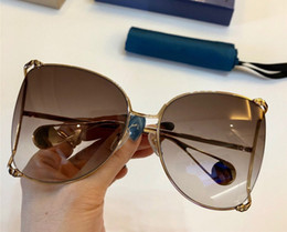 $enCountryForm.capitalKeyWord Australia - 0252 Classic Women Sunglasses Fashion Designer Metal big Hollow Frame Glasses Mosaic pearl Design Top Quality UV400 Protection With Case