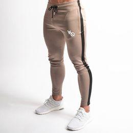 d63cd172b70f 2019 New Men Joggers Casual Pants Fitness Male Sportswear Tracksuit Bottoms  Skinny Sweatpants Trousers Gyms Crossfit Track Pants