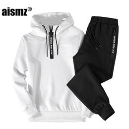 Aismz otoño invierno primavera 2018 nuevos hombres chándal conjuntos de dos piezas sudaderas con capucha + pantalones Sportwear traje masculino sudaderas en venta
