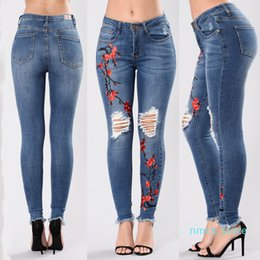 Discount women s embroidered pants Womens Designer Jeans Hole Embroidered Chinese Style Slim Dark Blue Skinny Pencil Pants Fashion Womens Pants XM08