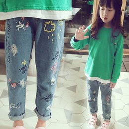 graffiti kids clothes Australia - Personality cloud graffiti printing hole casual children jeans,Children's Clothing For Girl Kids Pants Boutique Children Trouser Y200409