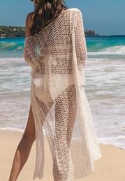 Vente en gros Veste de bikini évidée en dentelle en vrac pour la veste de maillot de bain pour femmes en bord de mer, avec protection contre le soleil sur le sable