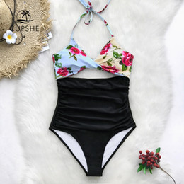 fe6beadeabccd CUPSHE Floral Print And Black Twist Halter One-Piece Swimsuit Women Cutout  Ruched Monokini Swimwear 2019 Girl Beach Bathing Suit