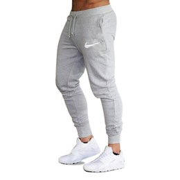 Skinny Trousers UK - 2019 New Men Gyms Pants Casual Elastic Muscle cotton Mens Fitness Workout Pants skinny Sweatpants Trousers Jogger