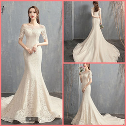 Pictures White Short Gown Sexy Australia - Robe de mariage 2019 white champagne lace mermaid wedding dress short sleeve sheer neck sexy court train elegant bridal gowns hot sale 2019