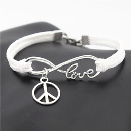 $enCountryForm.capitalKeyWord Australia - Newest Fashion Infinity Love Peace Symbols Round Cross Pendants Bracelet Bangles for Women Men White Braided Leather Suede Rope Jewelry Gift