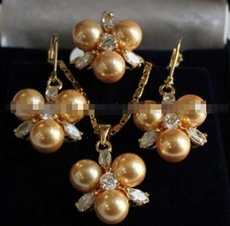 $enCountryForm.capitalKeyWord Australia - FREE SHIPPING 8MM Golden South sea Shell Pearl Earrings  Ring   Necklace Pendant Set ring 7-9
