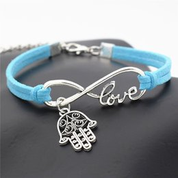 wholesale blue eye bracelet NZ - New Blue Leather Suede Rope Wrap Braided Men Women Bracelet Infinity Love Hamsa Symbol Evil Eye Fatima Hand Palm Pendant Jewelry Accessories