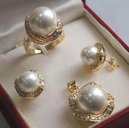 $enCountryForm.capitalKeyWord Australia - silver 18GP luxurious South Sea Shell Pearl Jewelry Set (ring pendant earrings) Women free shipping