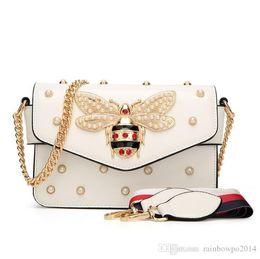 $enCountryForm.capitalKeyWord Australia - Factory outlet brand women handbag new pearl chain bag small bees lock women shoulder bag personality color studded Messenger bag