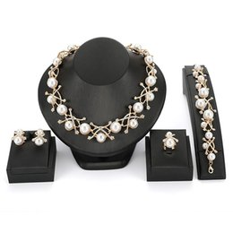 Wholesale 2018 New Hot Bridal Wedding Elegant Accessories Imitation Pearl Jewelry Alloy Necklace Earrings Ring Bracelet Four Piece Set