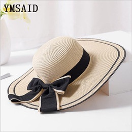 large brim straw NZ - Ymsaid Summer Big bowknot Straw Hats Foldable Beach Hats for Women Female Sunbonnet Ladies Vacation Large Wide Brimmed Sun Hats C18122501