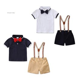 Polo Clothes Wholesale Australia - Summer boys outfits kids Bows tie lapel short sleeve polo shirt+double pocket stripe suspender shorts 2pcs sets Baby boy clothes F7305