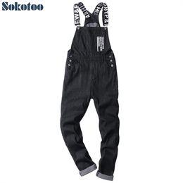 Fitted Denim Jumpsuit Australia - Sokotoo Men's slogan letters printed black denim bib overalls Fashion slim fit jumpsuits Plus size jeans pants #345726