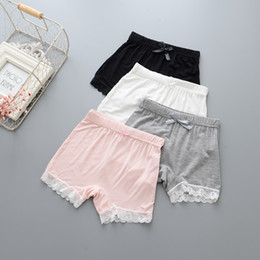 Grey babies pants online shopping - Solid color baby girls safety underwear pants with lace trim children kids summer shorts pants white pink grey black beige colors offer